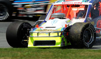 LOUDON, NH - JULY 16:  Erick Rudolph, driver of the Accell Construction Chevrolet, spins out during the NASCAR Whelen Modified Tour F.W. Webb 100 at New Hampshire Motor Speedway on July 16, 2011 in Loudon, New Hampshire.  (Photo by Jared C. Tilton/Getty I