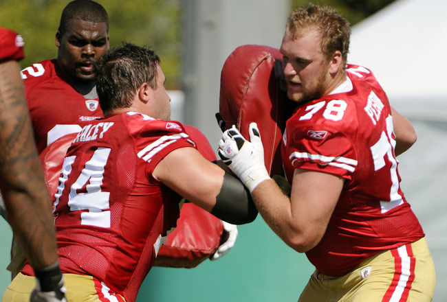 SANTA CLARA, CA - JULY 30: Mike Person #78 and Joe Staley #74 of the San Francisco 49ers participate in drills during practice at the San Francisco 49ers training facility on July 30, 2011 in Santa Clara, California. (Photo by Thearon W. Henderson/Getty I