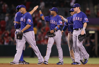 ANAHEIM, CA - JULY 19:  (L-R) Nelson Cruz #17, Endy Chavez #9, Elvis Andrus #1 and Josh Hamilton #32 of the Texas Rangers congratulate each other following their teams victory over the Los Angeles Angels of Anaheim at Angel Stadium of Anaheim on July 19,