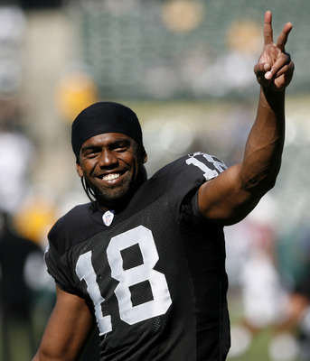 Oakland receiver Randy Moss jesters to the crowd in the Black Hole as the Oakland Raiders defeated the Arizona Cardinals by a score of 22 to 9 at McAfee Coliseum, Oakland, California, October 22, 2006. (Photo by Robert B. Stanton/NFLPhotoLibrary)