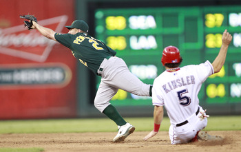 ARLINGTON, TX - JULY 7: Ian Kinsler #5 of the Texas Rangers beats the throw on Cliff Pennington #2 of the Oakland Athletics at Rangers Ballpark in Arlington on July 7, 2011 in Arlington, Texas. (Photo by Rick Yeatts/Getty Images)