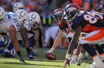 DENVER - SEPTEMBER 26:  Defensive tackle Dan Muir #90 lines up opposite center J.D. Walton #50 of the Denver Broncos as he prepares to snap the ball at INVESCO Field at Mile High on September 26, 2010 in Denver, Colorado. The Colts defeated the Broncos 27