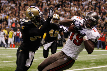 NEW ORLEANS, LA - JANUARY 02:   Mike Williams #19 of the Tampa Bay Buccaneers catches a touchdown pass over Jabari Greer #33 of the New Orleans Saints at the Louisiana Superdome on January 2, 2011 in New Orleans, Louisiana.  The Buccaneers defeated the Sa