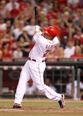 CINCINNATI, OH - JULY 27: Yonder Alonso #23 of the Cincinnati Reds swings at a pitch during the game against the New York Mets at Great American Ball Park on July 27, 2011 in Cincinnati, Ohio.  (Photo by Andy Lyons/Getty Images)