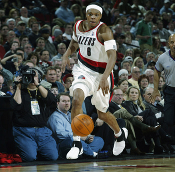 PORTLAND, OR - MARCH 6:  Bonzi Wells #6 of the Portland Trail Blazers dribbles against the Philadelphia 76ers during the game at The Rose Garden on March 6, 2003 in Portland, Oregon.  The 76ers won 88-60.  NOTE TO USER: User expressly acknowledges and agr