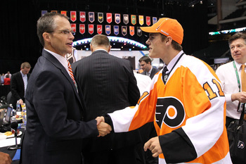 ST PAUL, MN - JUNE 25:  68th overall pick Nick Cousins by the Philadelphia Flyers is greeted by a members of the Philadelphia Flyers organization during day two of the 2011 NHL Entry Draft at Xcel Energy Center on June 25, 2011 in St Paul, Minnesota.  (Ph