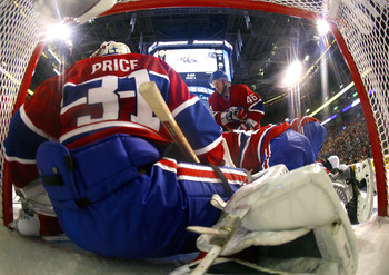 MONTREAL, CANADA - APRIL 26:  Carey Price #31 of the Montreal Canadiens defends his net while teammate Andrei Kostitsyn #46 skates in the pick up a rebound in Game Six of the Eastern Conference Quarterfinals against the Boston Bruins during the 2011 NHL S