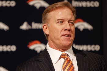 ENGLEWOOD, CO - JANUARY 14:  Denver Broncos vice president of football operations John Elway addresses the media during a press conference to announce John Fox as the next head coach at Dove Valley on January 14, 2011 in Englewood, Colorado. Fox was named