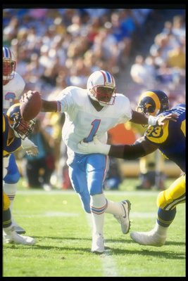 4 Nov 1990:  Quarterback Warren Moon of the Houston Oilers attempts to avoid a sack during a game against the Los Angeles Rams at Anaheim Stadium in Anaheim, California.  The Rams won the game, 17-13. Mandatory Credit: Stephen Dunn  /Allsport