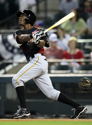 PHOENIX, AZ - JULY 10:  World Future's All-Star Starling Marte #15 of the Pittsburgh Pirates at bat during the 2011 XM All-Star Futures Game at Chase Field on July 10, 2011 in Phoenix, Arizona.  (Photo by Jeff Gross/Getty Images)