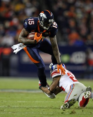 DENVER - NOVEMBER 26:  Wide receiver Brandon Marshall #15 of the Denver Broncos makes a pass reception and is tackled by Terrell Thomas #24 of the New York Giants during NFL action at Invesco Field at Mile High on November 26, 2009 in Denver, Colorado. Th