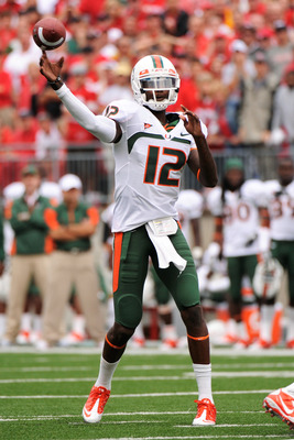 COLUMBUS, OH - SEPTEMBER 11:  Quarterback Jacory Harris #12 of the Miami Hurricanes attempts a pass against the Ohio State Buckeyes at Ohio Stadium on September 11, 2010 in Columbus, Ohio.  (Photo by Jamie Sabau/Getty Images)