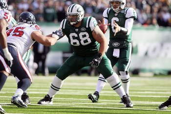 EAST RUTHERFORD, NJ - NOVEMBER 21:  Matt Slauson #68 of the New York Jets in action against the Houston Texans on November 21, 2010 at the New Meadowlands Stadium in East Rutherford, New Jersey.  (Photo by Jim McIsaac/Getty Images)