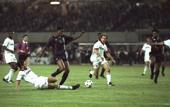 24 May 1995:  Patrick Kluivert (centre left) of Ajax robs Franco Baresi (left) of AC Milan of the ball during the European Cup Final in Vienna, Austria. Ajax won the match 1-0. \ Mandatory Credit: Clive  Brunskill/Allsport