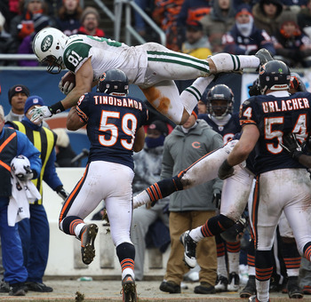 CHICAGO, IL - DECEMBER 26: Dustin Keller #81 of the New York Jets goes airbourne over Pisa Tinoisamoa #59 of the Chicago Bears for a first down at Soldier Field on December 26, 2010 in Chicago, Illinois. The Bears defeated the Jets 38-34. (Photo by Jonath