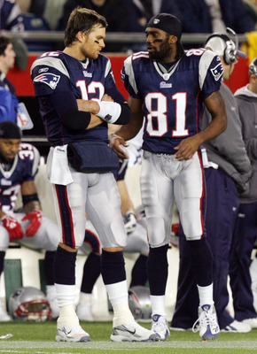 FOXBORO, MA - DECEMBER 23:  Randy Moss #81 and Tom Brady #12 of the New England Patriots talk on the sideline during a timeout against the Miami Dolphins during their game at Gillette Stadium on December 23, 2007 in Foxboro, Massachusetts.  (Photo by Jim