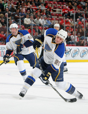 DETROIT, MI - DECEMBER 15:  Alexander Steen #20 of the St.Louis Blues shoots the puck against the Detroit Red Wings during their NHL game at Joe Louis Arena on December 15, 2010 in Detroit, Michigan.(Photo By Dave Sandford/Getty Images)