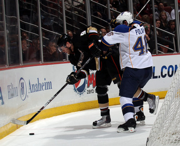ANAHEIM, CA - JANUARY 12: Roman Polak #46 of the St. Louis Blues hits Bobby Ryan #9 of the Anaheim Ducks at the Honda Center on January 12, 2011 in Anaheim, California.  (Photo by Bruce Bennett/Getty Images)
