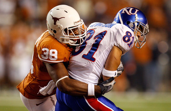 AUSTIN, TX - NOVEMBER 21:  Wide receiver Johnathan Wilson #81 of the Kansas Jayhawks is tackled by Roddrick Muckelroy #38 of the Texas Longhorns at Darrell K Royal-Texas Memorial Stadium on November 21, 2009 in Austin, Texas.  (Photo by Ronald Martinez/Ge
