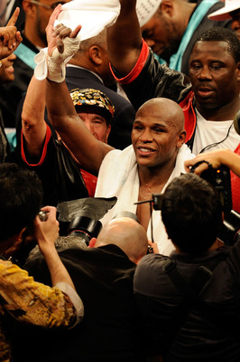 LAS VEGAS - MAY 01:  Floyd Mayweather Jr. reacts after defeating Shane Mosley by unanimous decision after the welterweight fight at the MGM Grand Garden Arena on May 1, 2010 in Las Vegas, Nevada.  (Photo by Ethan Miller/Getty Images)