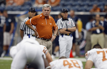 HOUSTON - SEPTEMBER 04:  Head coach Mack Brown of the Texas Longhorns looks over the team during warm ups before playing the Rice Owls at Reliant Stadium on September 4, 2010 in Houston, Texas. Texas beat Rice 34-17.  (Photo by Bob Levey/Getty Images)