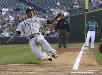 SEATTLE - JULY 29:  B.J. Upton #2 of the Tampa Bay Rays scores in the second inning on a double by teammate Casey Kotchman #11 against the Seattle Mariners at Safeco Field on July 29, 2011 in Seattle, Washington. (Photo by Otto Greule Jr/Getty Images)