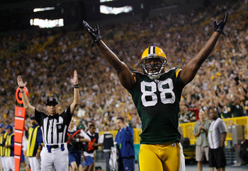 GREEN BAY, WI - AUGUST 26: Jermichael Finley #88 of the Green Bay Packers signals, along with a referee, a touchdown against the Indianapolis Colts during a preseason game at Lambeau Field on August 26, 2010 in Green Bay, Wisconsin. (Photo by Jonathan Dan