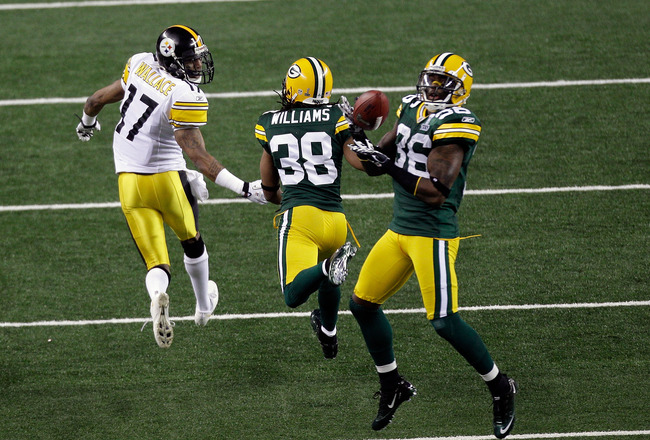 ARLINGTON, TX - FEBRUARY 06:  Nick Collins #36 of the Green Bay Packers makes an interception and runs 37 yards for a touchdown in the first quarter against the Pittsburgh Steelers during Super Bowl XLV at Cowboys Stadium on February 6, 2011 in Arlington,