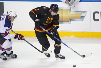 BUFFALO, NY - DECEMBER 30: Marcel Noebels #15 of Germany skates away from Nick Bjugstad #27 of the United States  during the 2011 IIHF World U20 Championship game between United States and Germany at the HSBC Arena on December 30, 2010 in Buffalo, New Yor