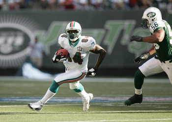NEW YORK - SEPTEMBER 18:  Chris Chambers #84 of the Miami Dolphins drops back to pass during the game with the New York Jets on September 18, 2005 at Giants Stadium in East Rutherford, New Jersey. The Jets defeated the Dolphins 17-7. (Photo by Al Bello/Ge