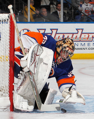 UNIONDALE, NY - MARCH 24:   Goalie Al Montoya #35 of the New York Islanders stops a shot by the Atlanta Thrashers during the first period of an NHL hockey game at the Nassau Coliseum on March 24, 2011 in Uniondale, New York.  (Photo by Paul Bereswill/Gett