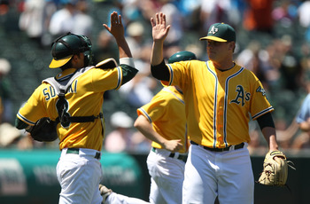 OAKLAND, CA - JULY 06:  Kurt Suzuki #8 and Andrew Bailey #40 of the Oakland Athletics celebrates after defetating the Seattle Mariners at the Oakland-Alameda County Coliseum on July 6, 2011 in Oakland, California.  (Photo by Jed Jacobsohn/Getty Images)
