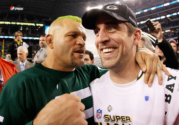 ARLINGTON, TX - FEBRUARY 06:  Former UFC Champion Chuck Liddell and Super Bowl MVP Aaron Rodgers #12 of the Green Bay Packers celebrate after the Packers won Super Bowl XLV 31-25 against the Pittsburgh Steelers at Cowboys Stadium on February 6, 2011 in Ar