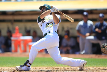 OAKLAND, CA - JULY 28:  Conor Jackson #28 of the Oakland Athletics hits a two run home run in the first inning against the Tampa Bay Rays at O.co Coliseum on July 28, 2011 in Oakland, California.  (Photo by Jed Jacobsohn/Getty Images)
