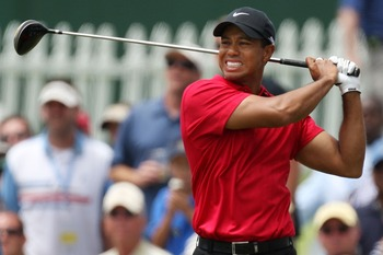 SAN DIEGO - JUNE 15:  Tiger Woods winces due to the pain from his knee injury after his tee shot during the final round of the 108th U.S. Open at the Torrey Pines Golf Course (South Course) on June 15, 2008 in San Diego, California.  (Photo by Ross Kinnai