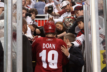 GLENDALE, AZ - APRIL 20:  Shane Doan #19 of the Phoenix Coyotes walks off the ice after being defeated by the Detroit Red Wings in Game Four of the Western Conference Quarterfinals during the 2011 NHL Stanley Cup Playoffs at Jobing.com Arena on April 20,