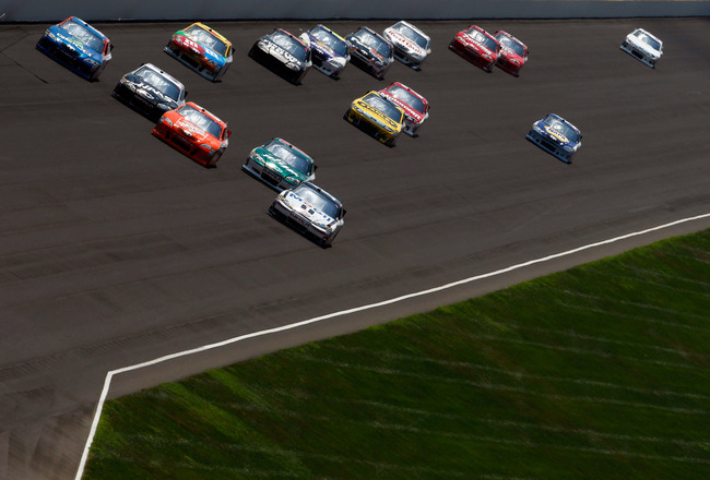INDIANAPOLIS, IN - JULY 31:  Cars race  during the NASCAR Sprint Cup Series Brickyard 400 at Indianapolis Motor Speedway on July 31, 2011 in Indianapolis, Indiana.  (Photo by Tom Pennington/Getty Images for NASCAR)