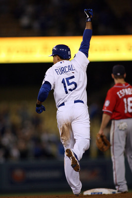 LOS ANGELES, CA - JULY 23:  Rafael Furcal #15 of the Los Angeles Dodgers celebrates his game-winning RBI double against the Washington Nationals in the ninth inning of the game at Dodger Stadium on July 23, 2011 in Los Angeles, California.  The Dodgers de