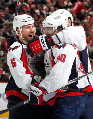 PHILADELPHIA, PA - MARCH 22:  Dennis Wideman #6 and Marcus Johansson #90 of the Washington Capitals celebrate a goal by Johansson against the Philadelphia Flyers during the third period of an NHL hockey game at the Wells Fargo Center on March 22, 2011 in