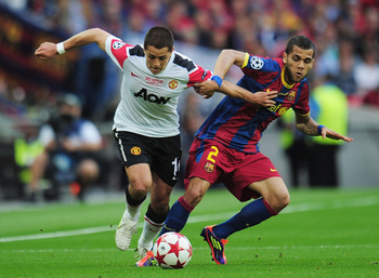 LONDON, ENGLAND - MAY 28:  Javier Hernandez of Manchester United (L) is challenged by Daniel Alves of FC Barcelona during the UEFA Champions League final between FC Barcelona and Manchester United FC at Wembley Stadium on May 28, 2011 in London, England.