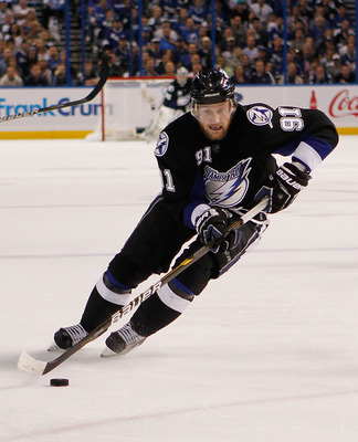 TAMPA, FL - MAY 19:  Steven Stamkos #91 of the Tampa Bay Lightning controls the puck in Game Three of the Eastern Conference Finals against the Boston Bruins during the 2011 NHL Stanley Cup Playoffs at St Pete Times Forum on May 19, 2011 in Tampa, Florida