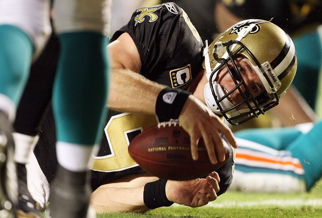 MIAMI - OCTOBER 25:  Quarterback Drew Brees #9 of the New Orleans Saints dives for a touchdown in the second half against the Miami Dolphins at Land Shark Stadium on October 25, 2009 in Miami, Florida. The Saints defeated the Dolphins 46-34.  (Photo by Do