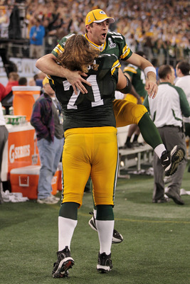 ARLINGTON, TX - FEBRUARY 06:  Aaron Rodgers #12 and Josh Sitton #71 of the Green Bay Packers celebrate after they defeated the Pittsburgh Steelers 31 to 25 in Super Bowl XLV at Cowboys Stadium on February 6, 2011 in Arlington, Texas.  (Photo by Jamie Squi