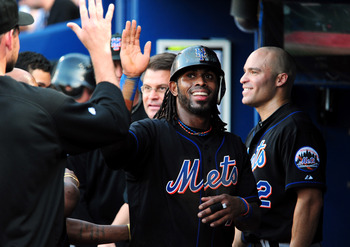 ATLANTA - JUNE 16: Jose Reyes #7 of the New York Mets is congratulated by teammates after scoring against the Atlanta Braves at Turner Field on June 16, 2011 in Atlanta, Georgia. (Photo by Scott Cunningham/Getty Images)