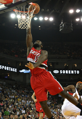 OAKLAND, CA - NOVEMBER 18:  Greg Oden #52 of the Portland Trail Blazers shoots over Anthony Morrow #22 of the Golden State Warriors during an NBA game on November 18, 2008 at Oracle Arena in Oakland, California. NOTE TO USER: User expressly acknowledges a