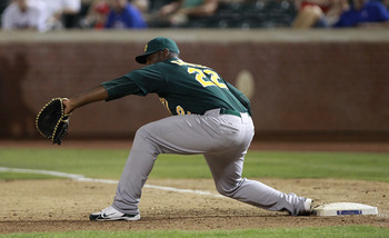 ARLINGTON, TX - JULY 7: Chris Carter #22 of the Oakland Athletics reaches for the catch for the out against the Texas Rangers at Rangers Ballpark in Arlington on July 7, 2011 in Arlington, Texas. (Photo by Rick Yeatts/Getty Images)