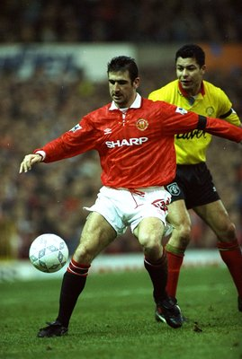 1993:  Eric Cantona of Manchester United shields the ball from Brian Gayle of Sheffield United during an FA Carling Premiership match at Old Trafford in Manchester, England. Manchester United won the match 2-0. \ Mandatory Credit: Anton  Want/Allsport