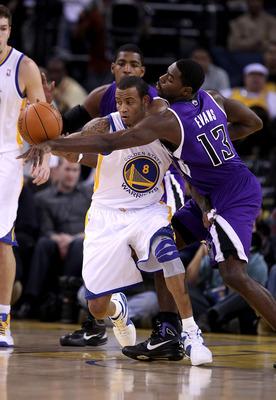 OAKLAND, CA - JANUARY 21:  Tyreke Evans #13 of the Sacramento Kings tries to steal the ball from Monta Ellis #8 of the Golden State Warriors at Oracle Arena on January 21, 2011 in Oakland, California. NOTE TO USER: User expressly acknowledges and agrees t