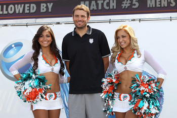 KEY BISCAYNE, FL - MARCH 25:  Mardy Fish poses for a photo with Cheerleaders from the Miami Dolphins during the Sony Ericsson Open at Crandon Park Tennis Center on March 25, 2011 in Key Biscayne, Florida.  (Photo by Clive Brunskill/Getty Images)