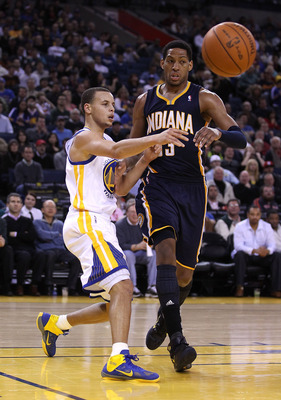 OAKLAND, CA - JANUARY 19:  Stephen Curry #30 of the Golden State Warriors passes the ball around Danny Granger #33 of the Indiana Pacers at Oracle Arena on January 19, 2011 in Oakland, California.  NOTE TO USER: User expressly acknowledges and agrees that